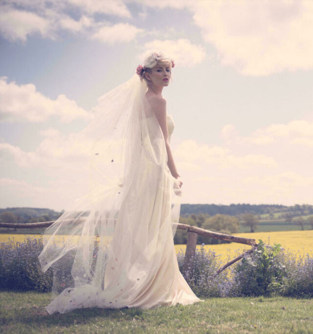 Professional photo of a bride standing in fields