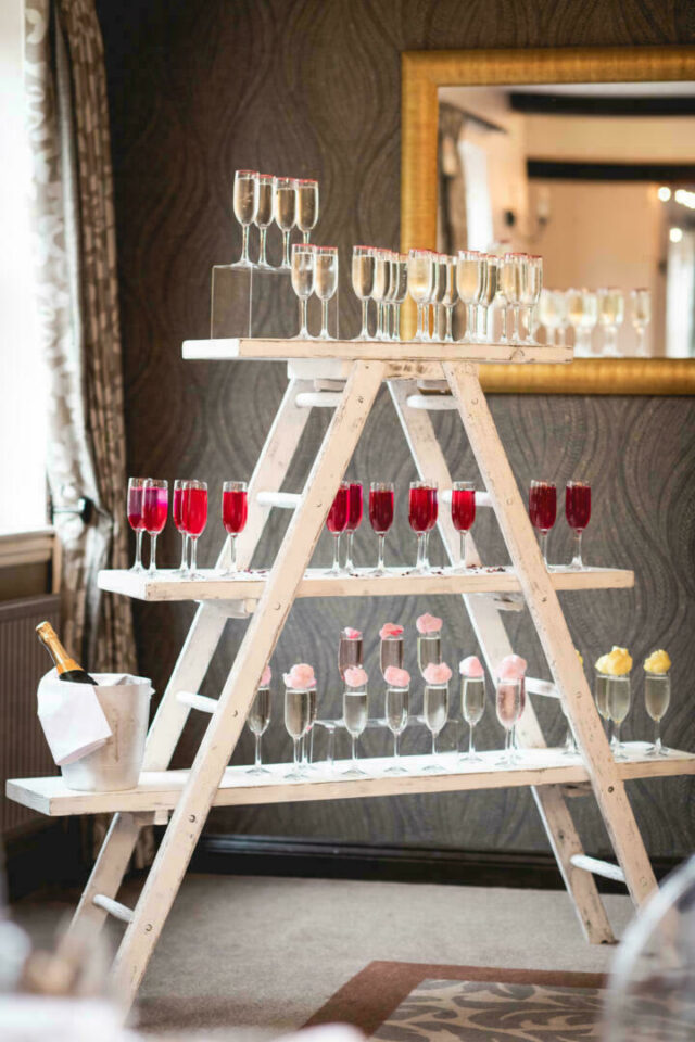 Trellis with champagne flutes