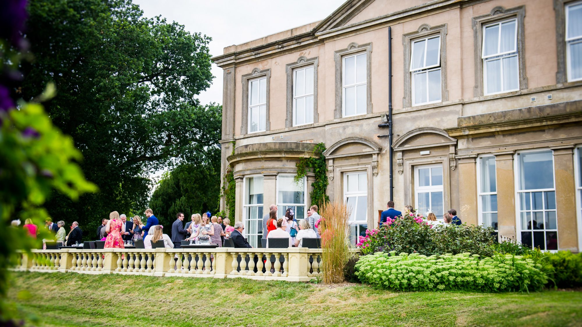Wedding party on the Hothorpe Hall top terrace