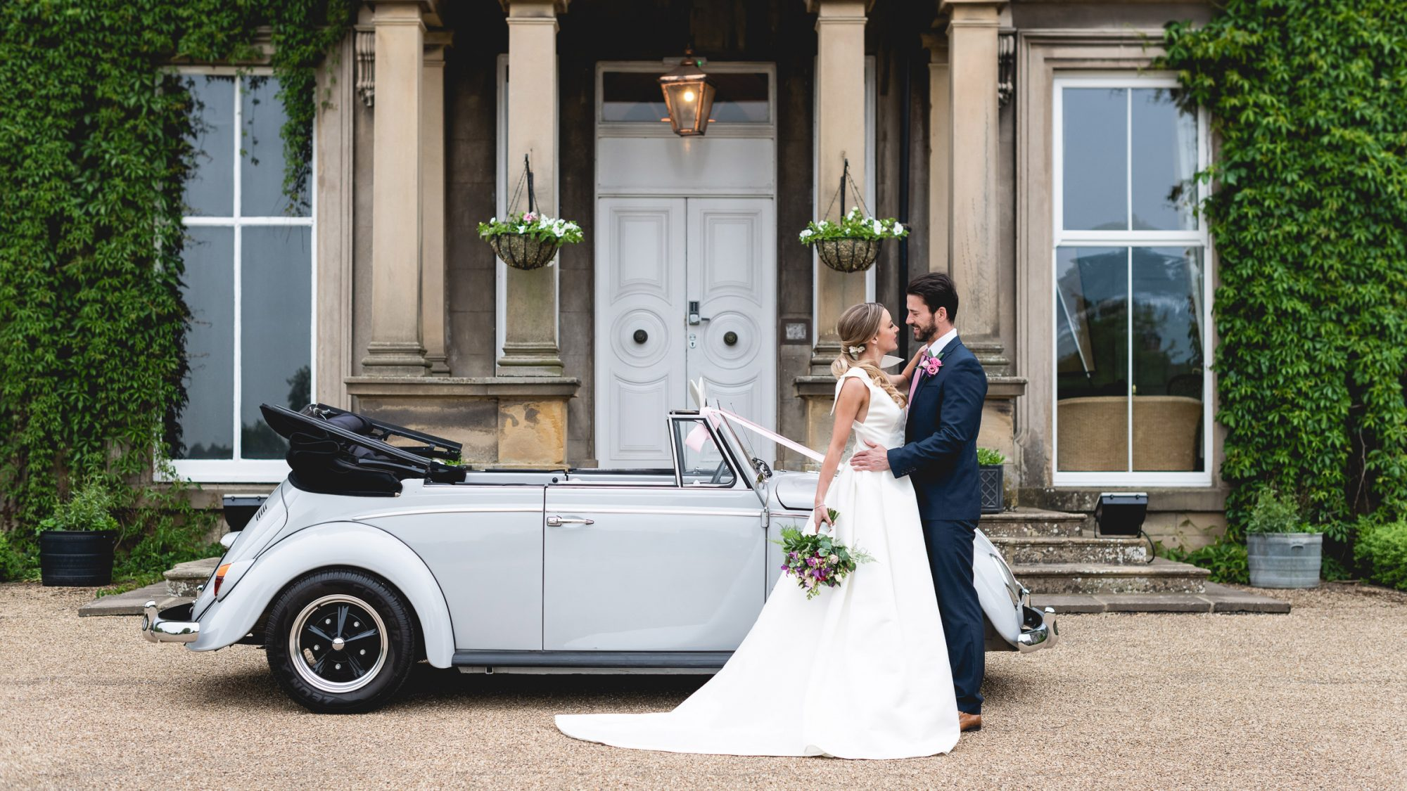 Bride & groom outside Hothorpe Hall