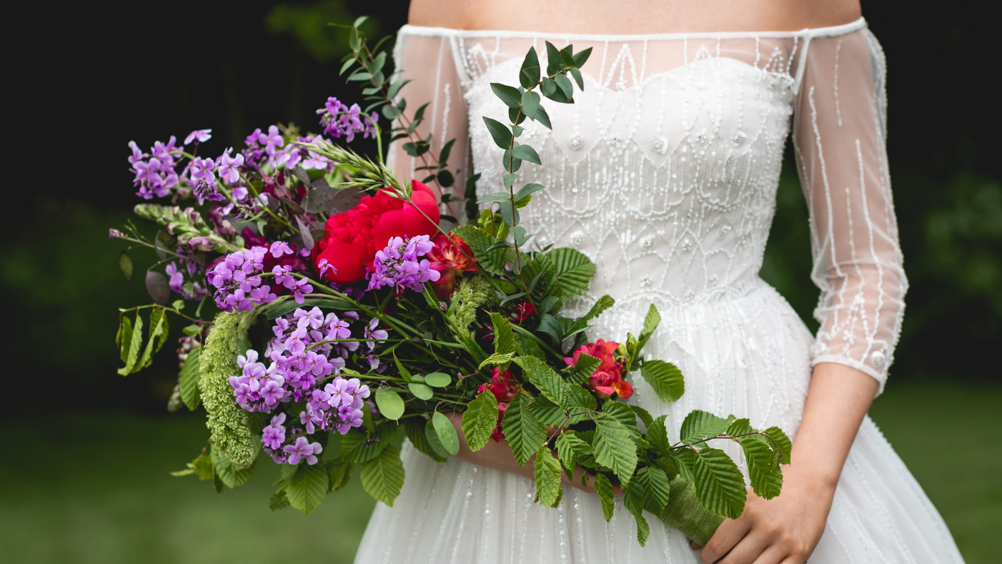 Bride with flowers at The Woodlands