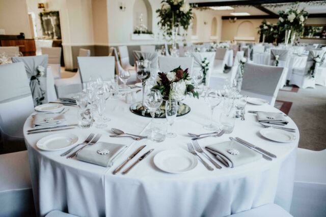 White cloth table setting for dining