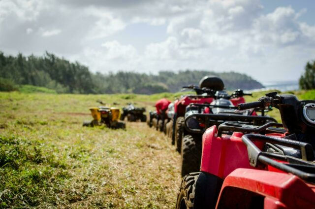 Quad bikes in a row