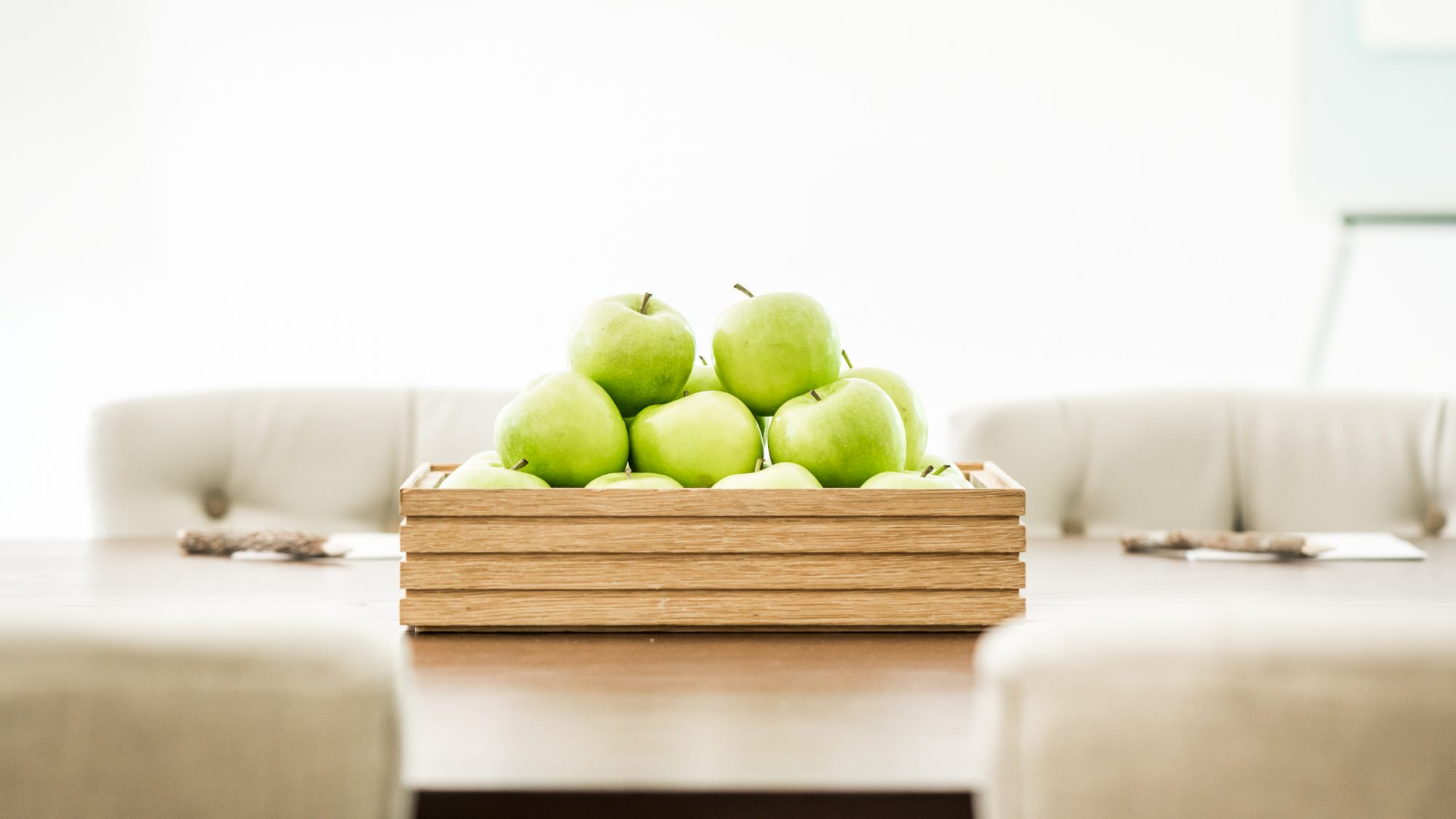 Green apple stack on table